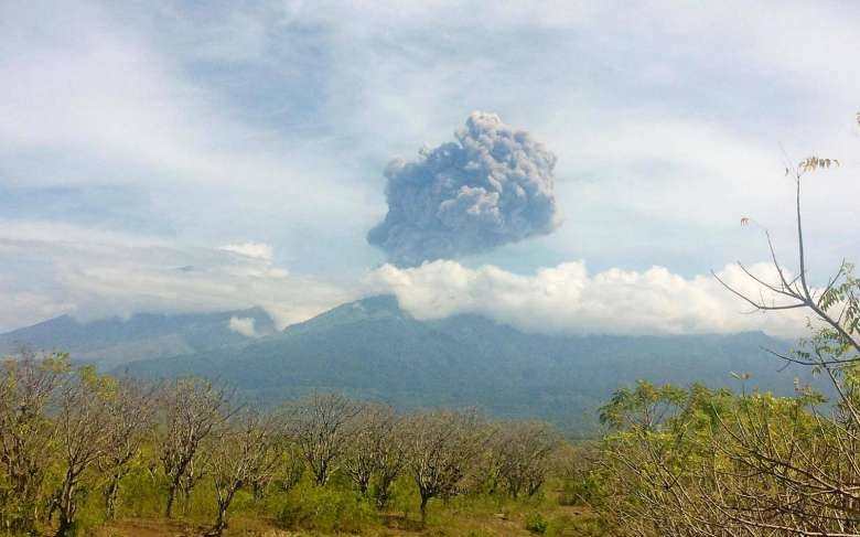 Mount Barujani, located inside Mount Rinjani volcano, is seen erupting from Bayan district, North Lombok, on Tuesday. Nearly 400 hikers in the area are being evacuated.