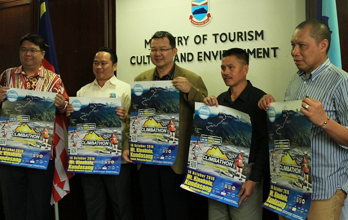 Pang, centre, showing off the 2016 Climbathon promotion posters at a Press Conference at the Sabah Tourism Board office in Kota Kinabalu, Thursday.