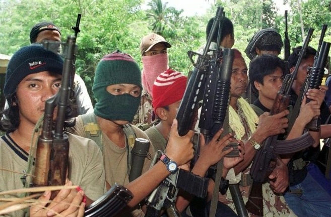 File photo of Abu Sayyaf gunmen who are believed to have kidnapped seven fishermen off Sabah's east coast waters near Lahad Datu, Tuesday night.