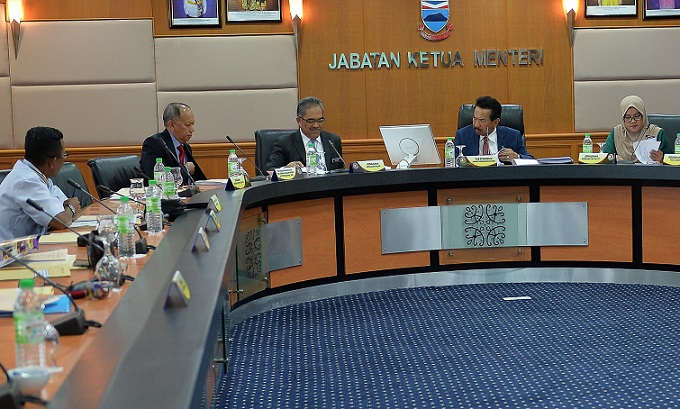 Musa, second from right, chairing the State Security Council meeting held at the Chief Minister's office meeting room in Wisma Innoprise on Tuesday.