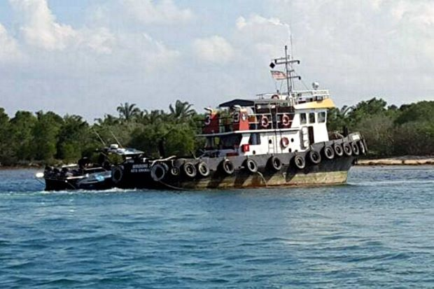 File photo of the tugboat that was spotted listing in Dent Haven waters in Lahad Datu after the incident.