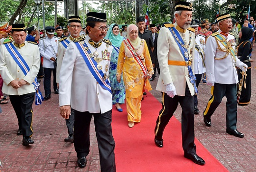 Musa Aman accompanies the Head of State to the main stage at Padang Merdeka Saturday for the parade in conjunction with Tun Juhar's official birthday.