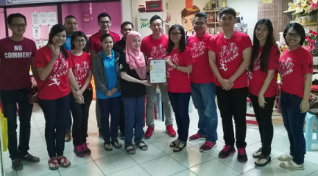Organizing chairlady, Aifei Lee, fifth from right 5, presenting a Certificate of Appreciation to the person in charge of the QEH Blood Bank.