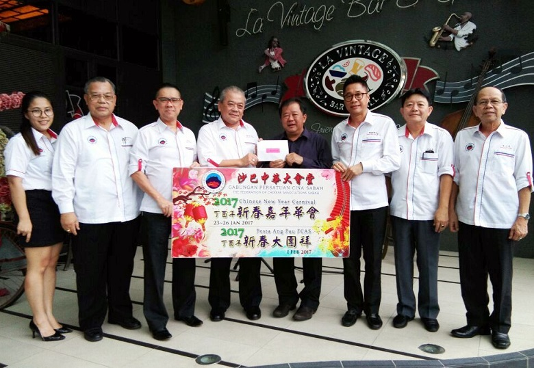 T.C. Goh, fourth from left, hands over the invitation card to Francis as members of FCAS Central Committee look on.