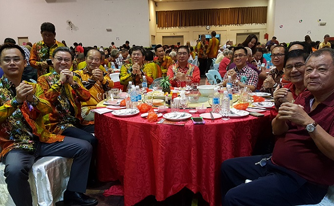 Dr Ongkili and the Chinese Chambers of Kota Marudu president, Lu Kim Yen, seated fourth left, together with the others, at the 2017 Ang Pow Festival and Dinner to recognise the contributions of senior citizens in Kota Marudu on Friday.