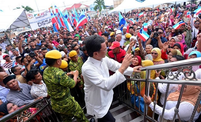 Shafie, acknowledging the crowd at his homeground Semporna, after he was dropped from the Federal Cabinet last year.