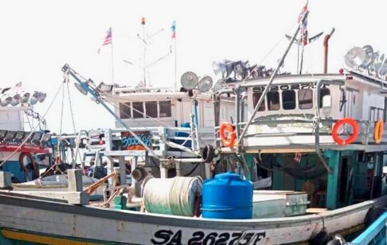 Fishing trawlers that frequently ply the seas off Sabah's east coast waters. Two were attacked by gunmen Tuesday night and the owner of one kidnapped.