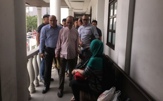 George on arrival at the Kota Kinabalu Sessions Court on Tuesday where he pleaded not guilty to a charge of cheating.