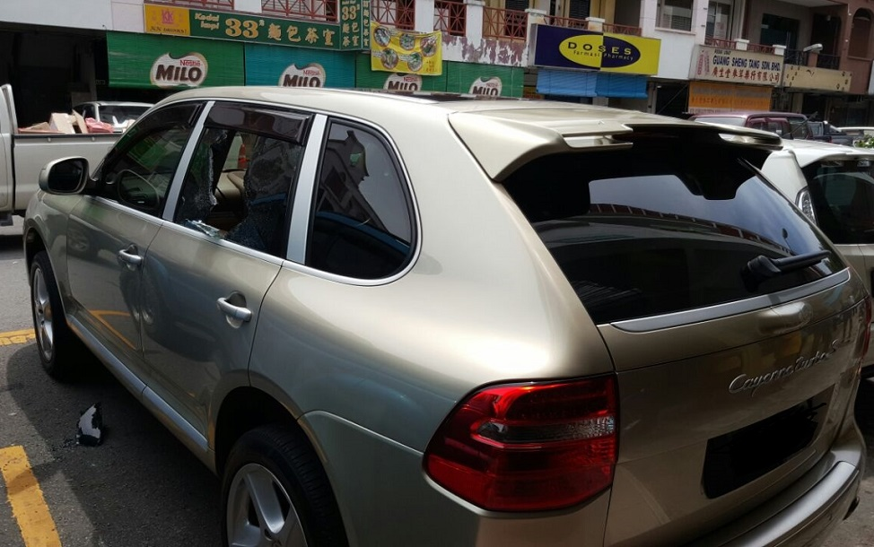 The rear passenger window of the car was smashed open and the bag of money stolen.