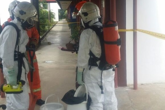 The hazmat team at the school to clean up the mercury spill Thursday.