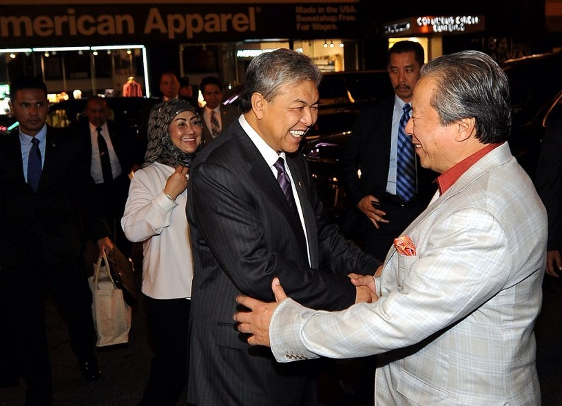 Anifah, right, greeting the deputy Prime Minister on his arrival to New York.
