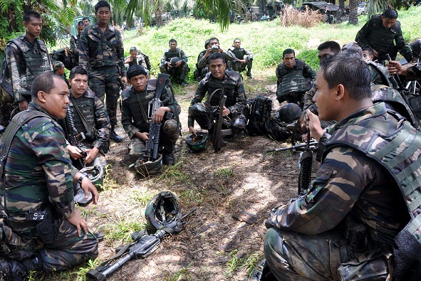 Malaysian soldiers in an undisclosed location in Sabah's east coast. Are there enough facilities for them?