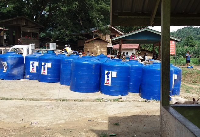 Scores of blue tanks waiting to be distributed in the interior.