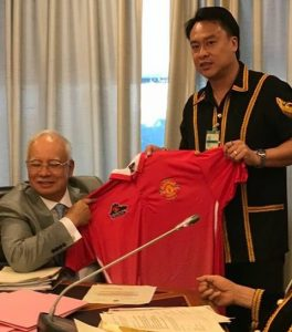 Jingulam hands over a MUSC-Sabah Red Devils replica jersey to the Prime Minister, who is a Manchester United supporter himself. - Photos courtesy of KSS