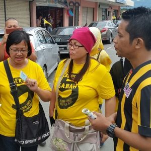 Maria Chin seen at left, about to be arrested in Kota Marudu on Saturday.