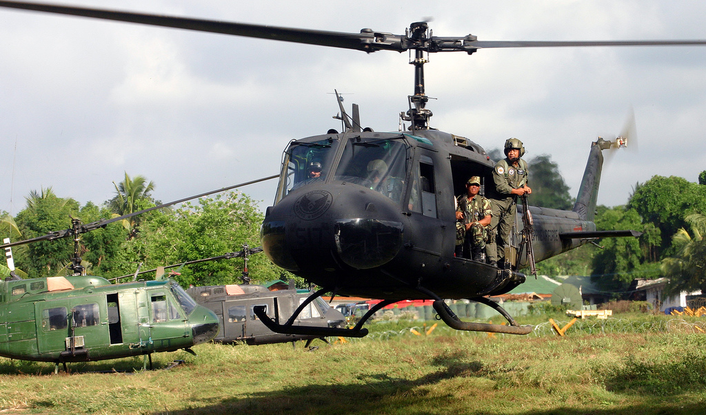"""Lorenzana, pictured below, says the value of U.S. military aid to the Philippines was """"not that much"""". File photo of a Huey chopper from the south Vietnam days and still very much of the Philippines Air Force."""