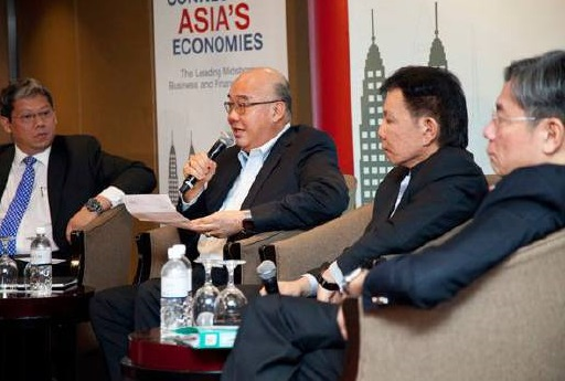 Chin Chee Kee, second left, says Labuan IBFC's unique qualities offer comprehensive options for Malaysian businesses that are going global to look at penetrating the ASEAN's burgeoning markets.