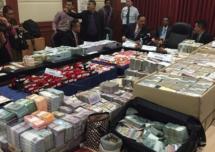 The MACC announced the success of their latest and biggest haul ever ― RM52 million in cash plus other forms of valuables, confiscated from two Water Department officers, and also froze the bank accounts of theirs and two others, said to contain a further RM60 million.