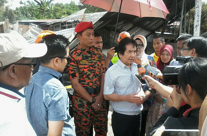 Kurup being interviewed by the media Sunday. He said he would assist the affected villagers. - Photos from social media