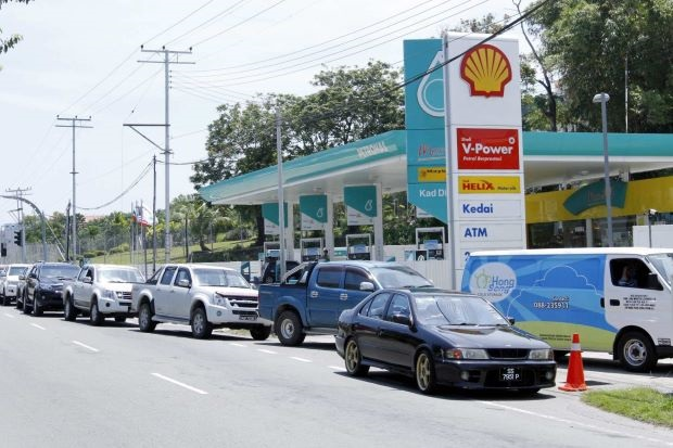 File photo of a petrol station along Penampang Road, where vehicles backed up a long way whenever there's an increase in fuel prices.
