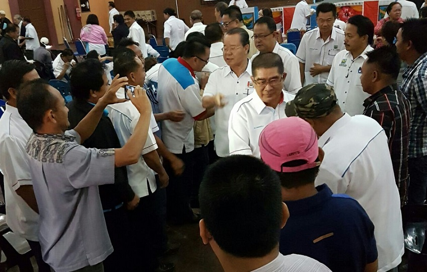 Dr Maximus and Datuk Radin Mallleh, being greeted by PBS members attending the seminar, as they make their way to the stage. - Photo courtesy of Therenes Voo