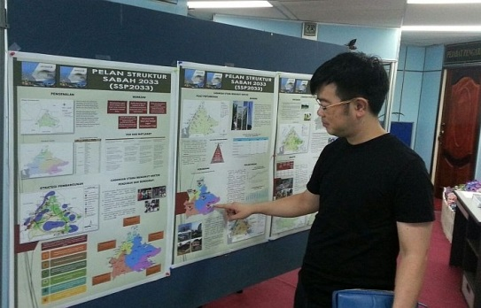 File photo of Junz reviewing the exhibit and contents of the state's 20-year structural plans when it was first exhibited in 2015. Photo courtesy of Junz Wong
