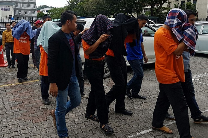 Some of the suspects being taken to the Kota Kinabalu