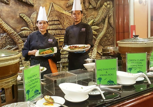 Thai chefs Sunantha, left and chef Pom showing the signature traditional Thai cuisines during the Authentic Thai Food promotion at Dorsett Grand Labuan.