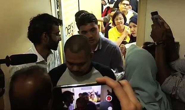 Maria Chin being led away by officials on the eve of Bersih 5 in Kuala Lumpur. She has since been detained under SOSMA.