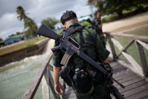 A Malaysian soldier carries a more modern version of the M 16. One of such make of rifles was discovered at Tanjung Batu olast Sunday.