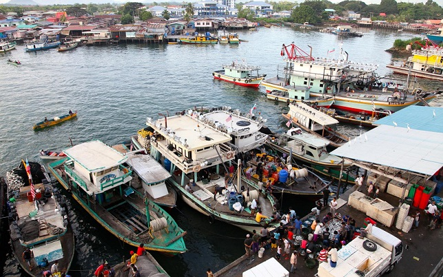 fishermen unload their catch at a dock in the town of Semporna in Sabah State in East Malaysia, on the island of Borneo.