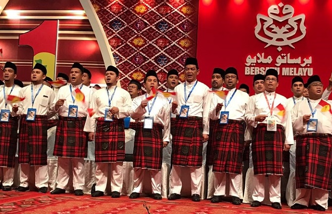 A section of the Umno Youth leadership Tuesday afternoon singing patrioitic party songs.