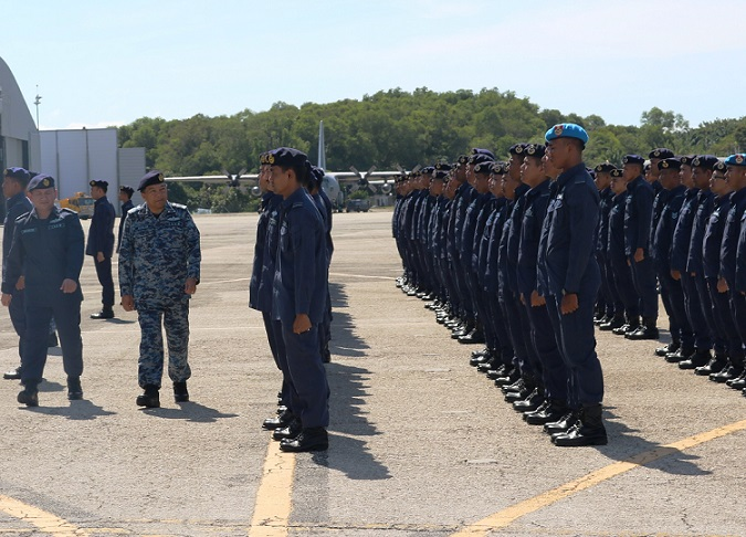 General Roslan Saad inspecting a guard of honour mounted for him by RMAF Labuan personnel Wednesday.