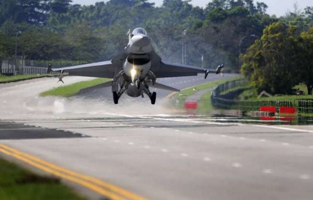 A F-16 fighter jet prepares to land on the Lim Chu Kang road Sunday.