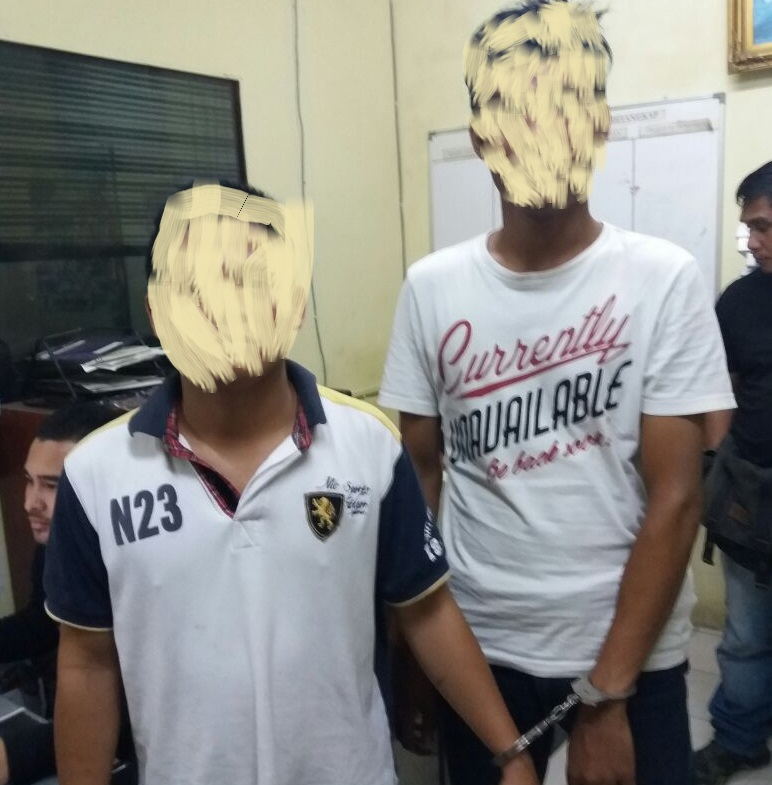 The main suspect and his relative were picked up from a house in Bukit Padang where they were hiding after their devious behaviour. - Photo credit PDRM Kota Kinabalu