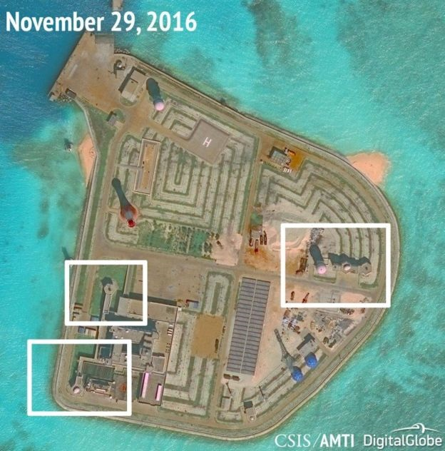 After previously committing to stop building up its military presence in the Spratly Islands, an US think tank has analyzed satellite images of a Chinese installation in the South China Sea and determined the Chinese have put in anti-aircraft guns on at least one of their artificial islands.