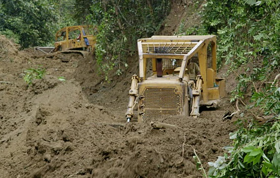 For illustration purposes. Bulldozers, belonging to a local company have started clearing a piece of land near the river for its site office and store