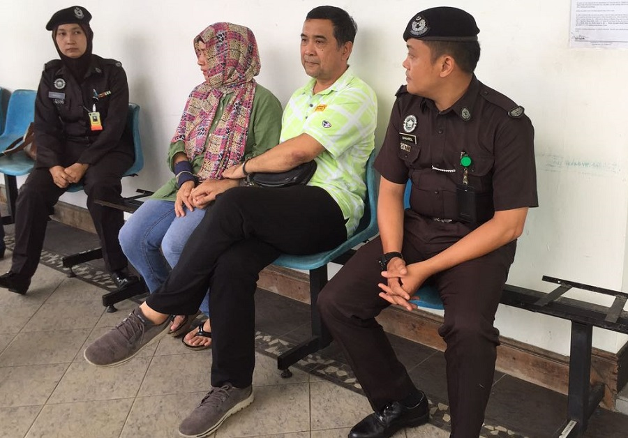 Ag Mohd Tahir, second right, and his wife Fauziah, outside the Kota Kinabalu High court Friday awaiting their turn for appeal in their bail to be reduced.