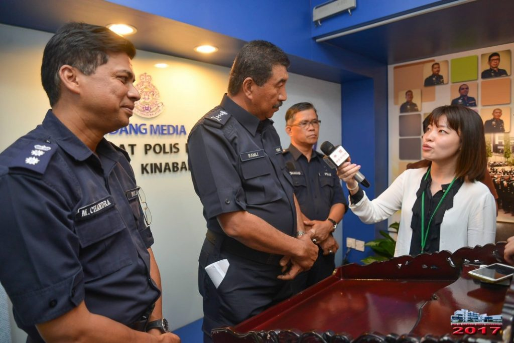 Ramli Din listens attentively to a question posed by a reporter from Hong Kong at Monday's press conference while Kota Kinabalu police chief, ACP M Chandra, left, looks on.