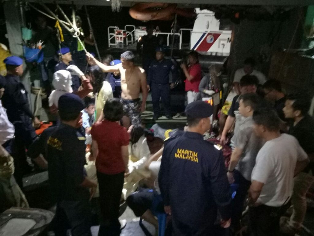 Some of the rescued tourists on board the trawler that brought them to Kota Kinabalu early Monday morning. All 20 were taken to the Queen Elizabeth Hospital for observation overnight.