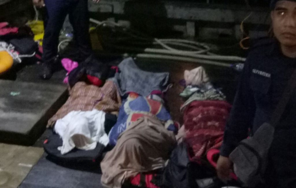 The three dead bodies lying on stretchers at the marine police jetty early Monday morning before they were taken to the Queen Elizabeth Hospital for a post mortem.