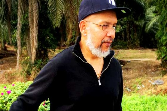 Sporting a cap and dressed in a dark long-sleeved polo shirt and jeans, convicted serial rapist Selva Kumar Subbiah was spotted at an undisclosed area in Sepang. - Photo credit FreeMalaysiaToday